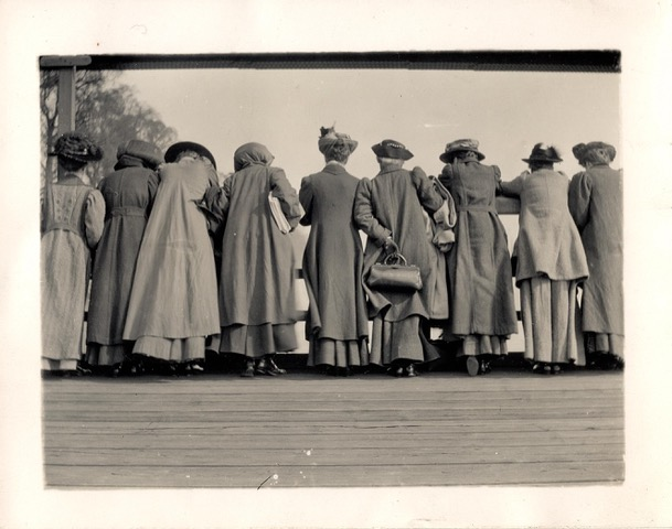 Edwardian women look over a parapet